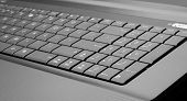 Close-up of modern laptop keyboard. In B/W