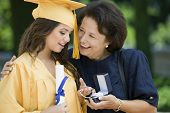 foto of early 20s  - Graduate Receiving Gift from Grandmother - JPG