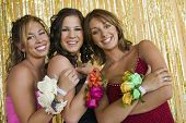 Smiling Teenage Girls Showing Prom Corsages