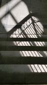 Geometric Striped Shadows From Window Lattice In Bright Sunlight On Stairway With Grey Marble Steps. poster