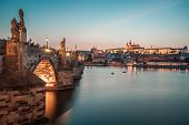 Prague Castle And Charles Bridge In The Evening, Prague, Czech Republic, Vltava River In Foreground. poster