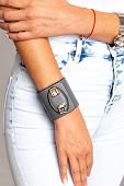 Grey Female Leather Bracelet With Iron Inserts On A Light Background. poster
