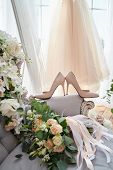 Luxury Beige Shoes On High Heels And Bridal Bouquet In Blur On Lavender Chesterfield Sofa With Bride poster