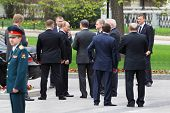 MOSCOW - MAY 8: Prime minister Vladimir Putin, bodyguards and State Duma deputies at ceremony of wre