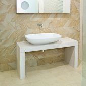 stock photo of lavabo  - Wide oval basin and marble ceramics with mirror - JPG