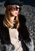 Eyewear Trend. Pretty Woman In Hat And Sunglasses And Furry Vest Urban Background. Fall Fashion Acce poster