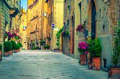 Picturesque Traditional Tuscany Street View. Beautiful Medieval Stone Houses And Paved Street With F poster