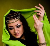 stock photo of concubine  - Beautiful young woman in color Arabian clothes - JPG