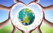 International Day Of Friendship Concept: Hands Holding A Heart And Earth Symbol poster