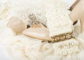 Beautiful wedding accessories and shoes on a white background