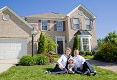 stock photo of nice house  - Family in Front of Their Home on a Nice Day - JPG