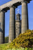 The Nelson Monument, Seen Through The Pillars Of The National Monument On Calton Hill, Edinburgh. poster
