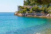 Three Colour Sea Water And A Castle On The Seaside. A Clean Transparent Water Of Adriatic Sea And Mi poster