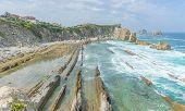Cantabrian coastline landscape in costa quebrada, Arnia Beach, Coast of Liencres Cantabria, Spain poster