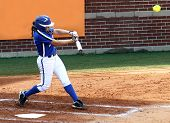 College Softball Player Swinging Bat