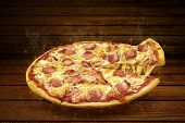 Pizza On Wooden Table. Flying Hot Pizza Pepperoni Closeup With Mozzarella Cheese And  Steam Smoke poster