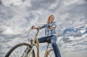 Girl Rides Bicycle Sky Background. Most Satisfying Form Of Self Transportation. Carefree And Satisfi poster