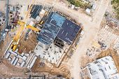 Construction Formwork In Construction Site. Aerial Topdown View Of High-rise Apartment Building Cons poster