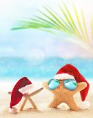 Starfish In Santa Hat On The Summer Beach. Christmas Concept poster