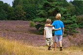 Kids Walking On Moor Land