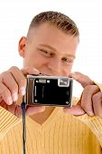 Young Man Holding Digital Camera