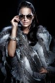 Pretty Woman Wearing Sunglasses And Beautiful Fur