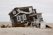 MANTOLOKING, NJ - JAN 13: A tilted home off its foundation on the beach on January 13, 2013 in Mantoloking, New Jersey. Clean up continues 75 days after Hurricane Sandy struck in October 2012.