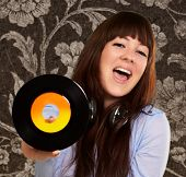 Portrait Of A Female Holding A Disc On Wallpaper