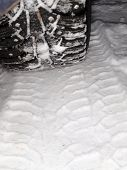 Winter Tire Tracks In Snow, Closeup, Focus On Tire