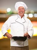 Male Chef Stirring A Non Stick Pan, Background