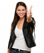 Beautiful Woman Giving Victory Sign Over A White Background