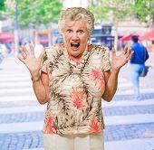 Portrait Of Shocked Senior Woman, Outdoors