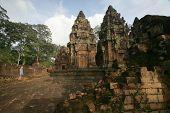 Ruins Of Angkor And Tourist poster