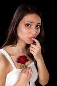 Woman hurting her finger on a red rose