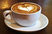 stock photo of glass heart  - A cup of coffee with heart shape on top - JPG