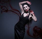 image of pale skin  - Beautiful vampire woman covered in blood - JPG