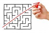 foto of maze  - Shortcut cutted through a maze by a red arrow - JPG