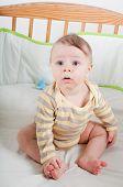 Baby boy in cradle