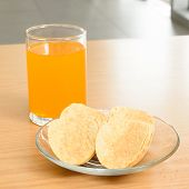 Orange Juice And Potato Chips On The Wooden Table