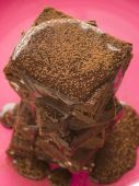 Stack Of Chocolate Brownies With Chocolate Fudge Sauce