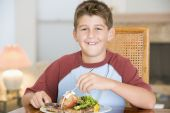 Young Boy Eating Meal, Mealtime