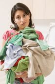 Woman Holding Pile Of Laundry