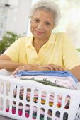 Woman Leaning On Washing Basket