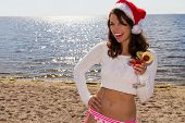 Woman With Drink On The Beach.  Christmas Vacation