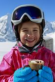 SKI, Apres ski, winter, child - young skier drinking hot chocolate  in winter resort