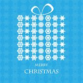Christmas Background.gift Box Made Of White Snowflakes On A Blue Background.vector