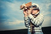 stock photo of little kids  - Little boy with wooden plane - JPG