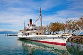 Vintage steam boat near the pier on the lake Leman (Switzerland)