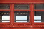 image of railcar  - Window detail of a brown empty nostalgic passenger car - JPG