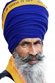 stock photo of sikh  - Portrait of Indian sikh man in turban with bushy beard - JPG